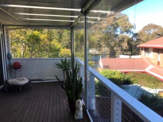 Outdoor Ziptrak Blinds installed by East Coast Shade Design at Budgewoi