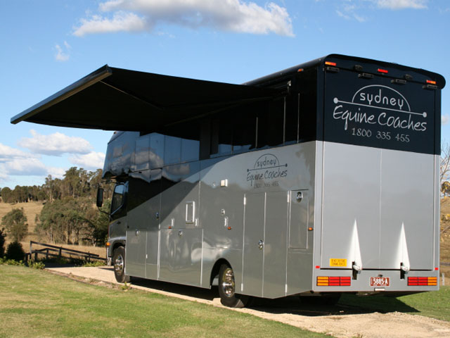Folding Arm Awning on Equestrian Vehicle - installed by East Coast Shade Design